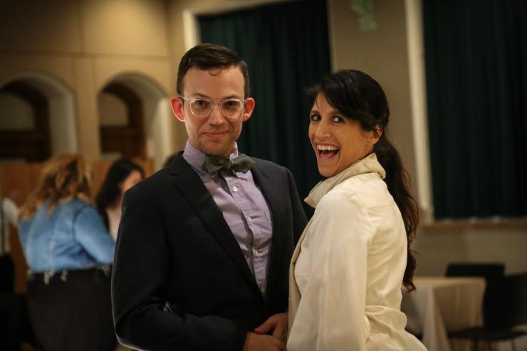 Two people posing at an event