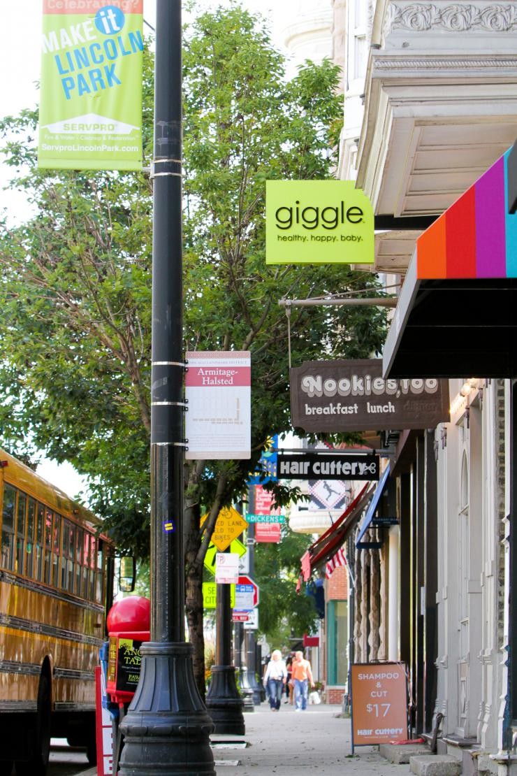 a sidewalk lined with stores