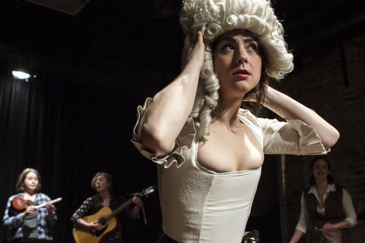 actress on stage in a wig and costume