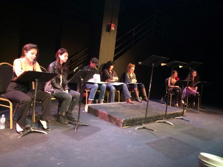 actors reading on stage