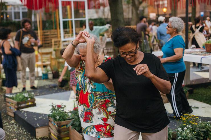 two community members dancing.