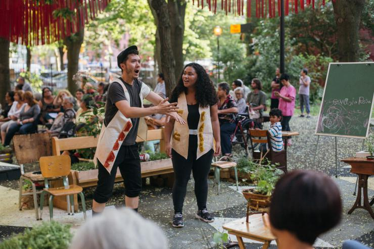 two artists performing in Meltzer Towers Garden