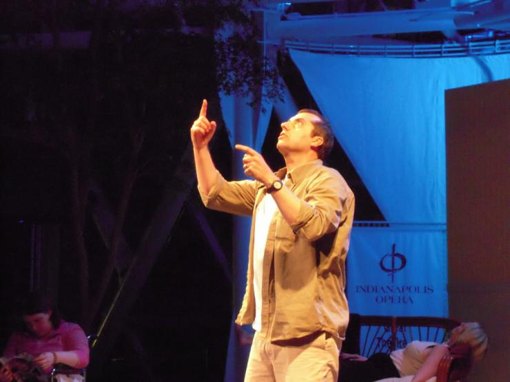 a performer on stage pointing