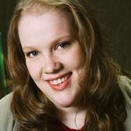 A woman smiling at the camera
