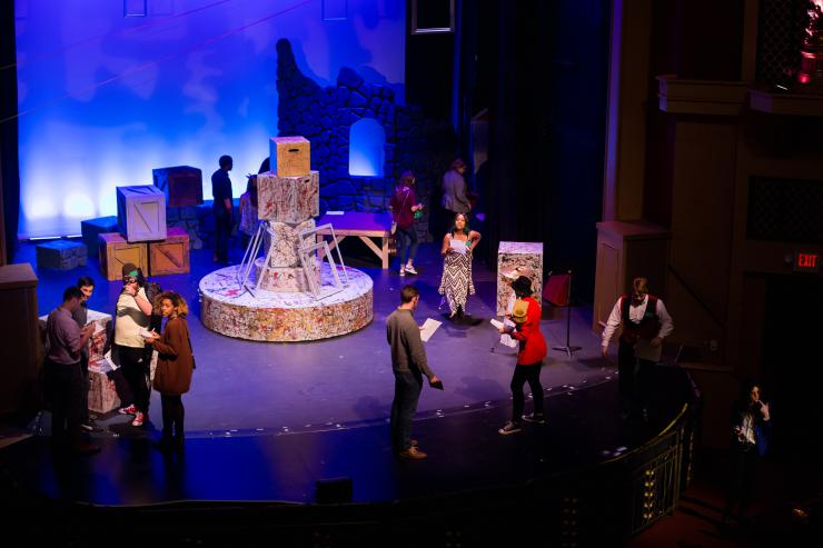 birds eye view of stage with actors and props