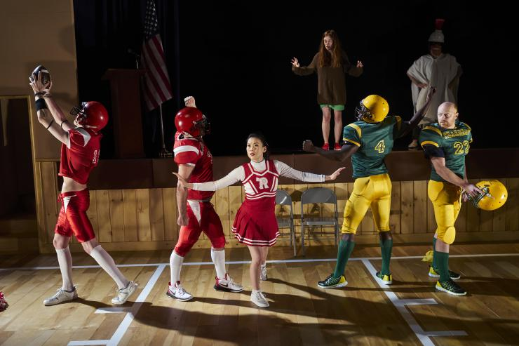 Actors tableau in a high school auditorium