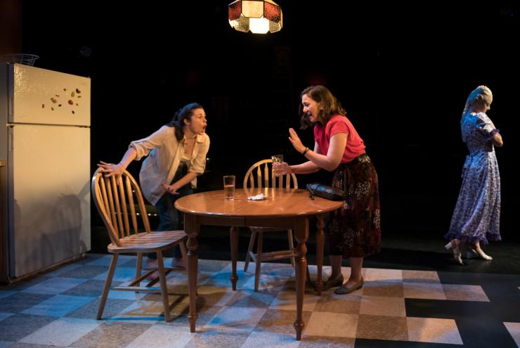 two women argue onstage