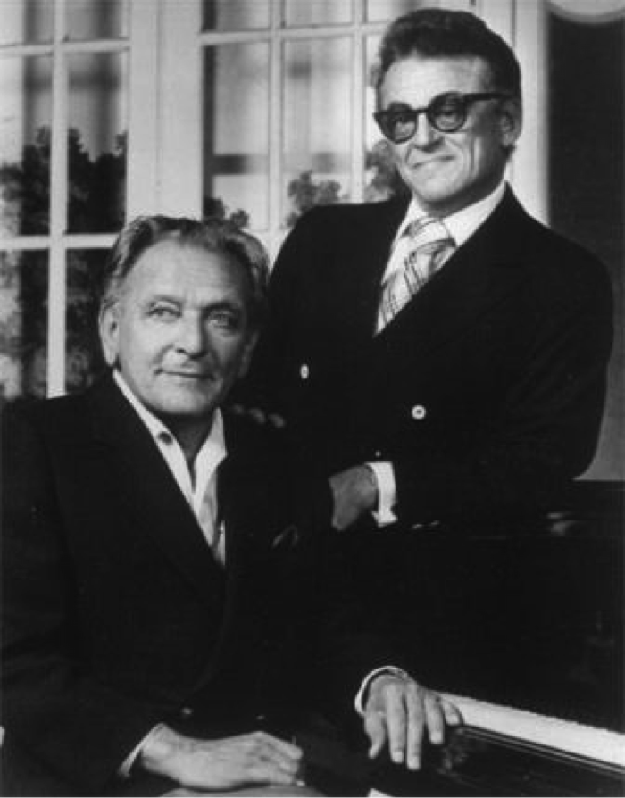 Loewe and Lerner posing with a piano