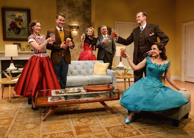 Actors toasting in a living room set