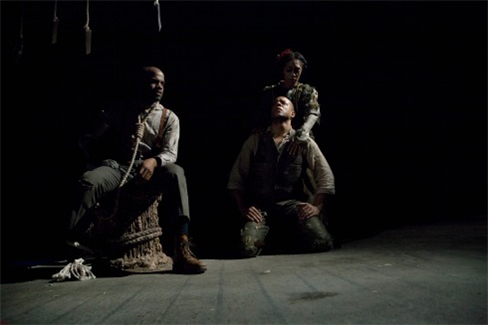three performers sitting onstage