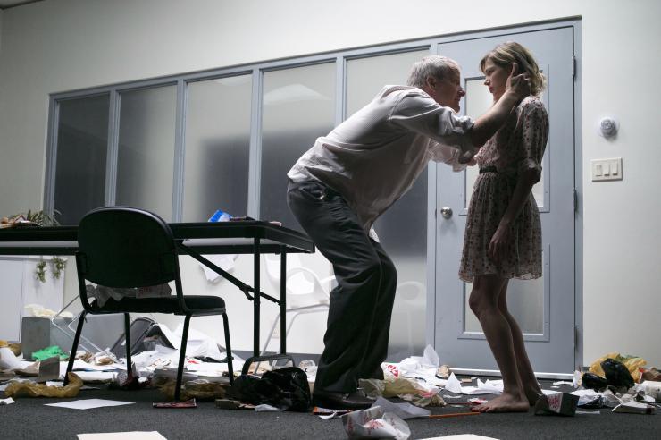 a man talking to a woman