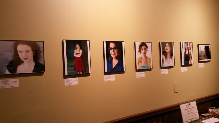 Wall with framed photographs of women playwrights