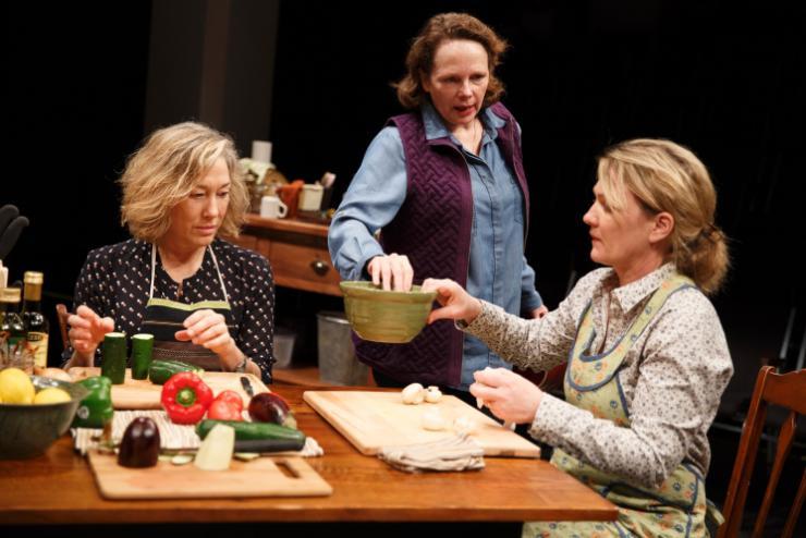 three women in a kitchen