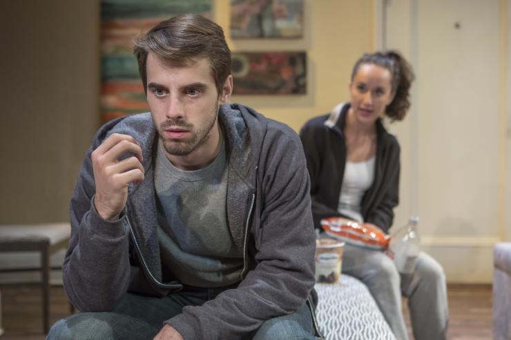 a woman talking to a man