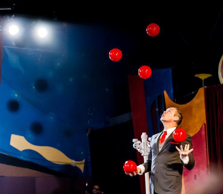 Man juggling red balls