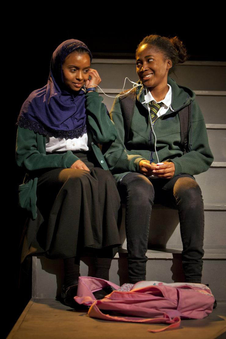 violence and female genital mutilation onstage in charlene james left to right tsion habte iqra and adelayo adedayo muna in cuttin it by charlene thomas photo courtesy of young vic theatre the royal court theatre