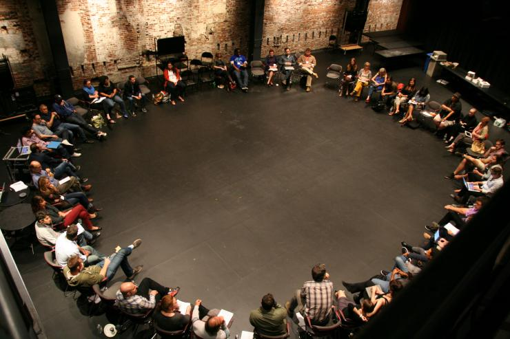 aerial view of convening participants sitting in a circle