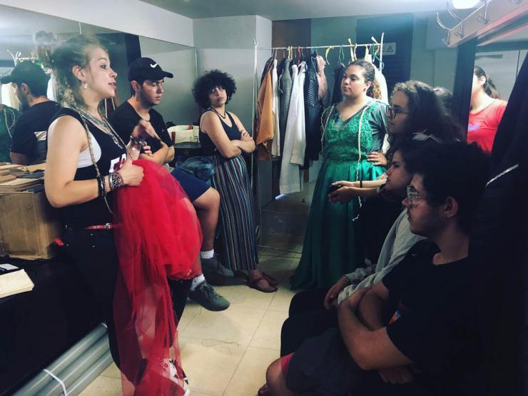 people talking in a dressing room