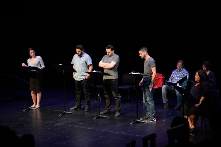 Actors on stage for a reading