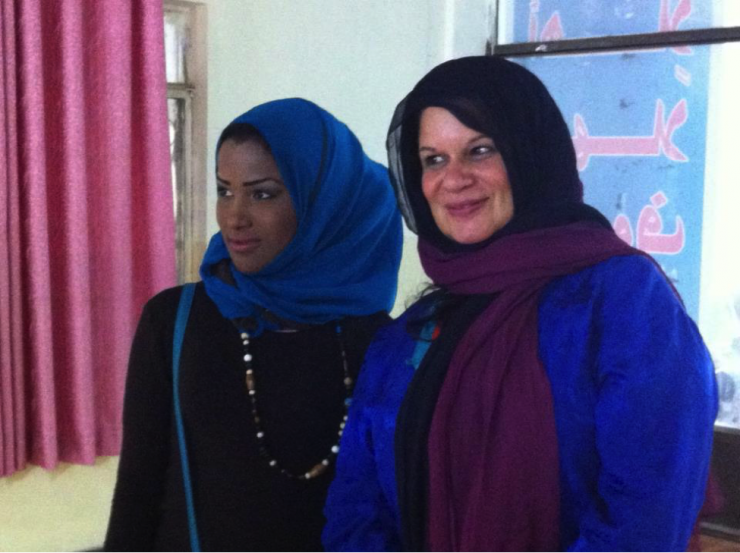 two women in hijabs smiling