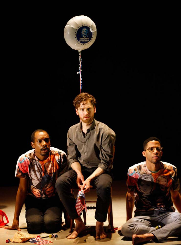 "three actors sit onstage with a balloon that says ""Madame President"""