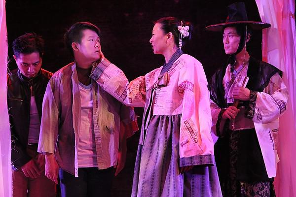 Four actors on stage