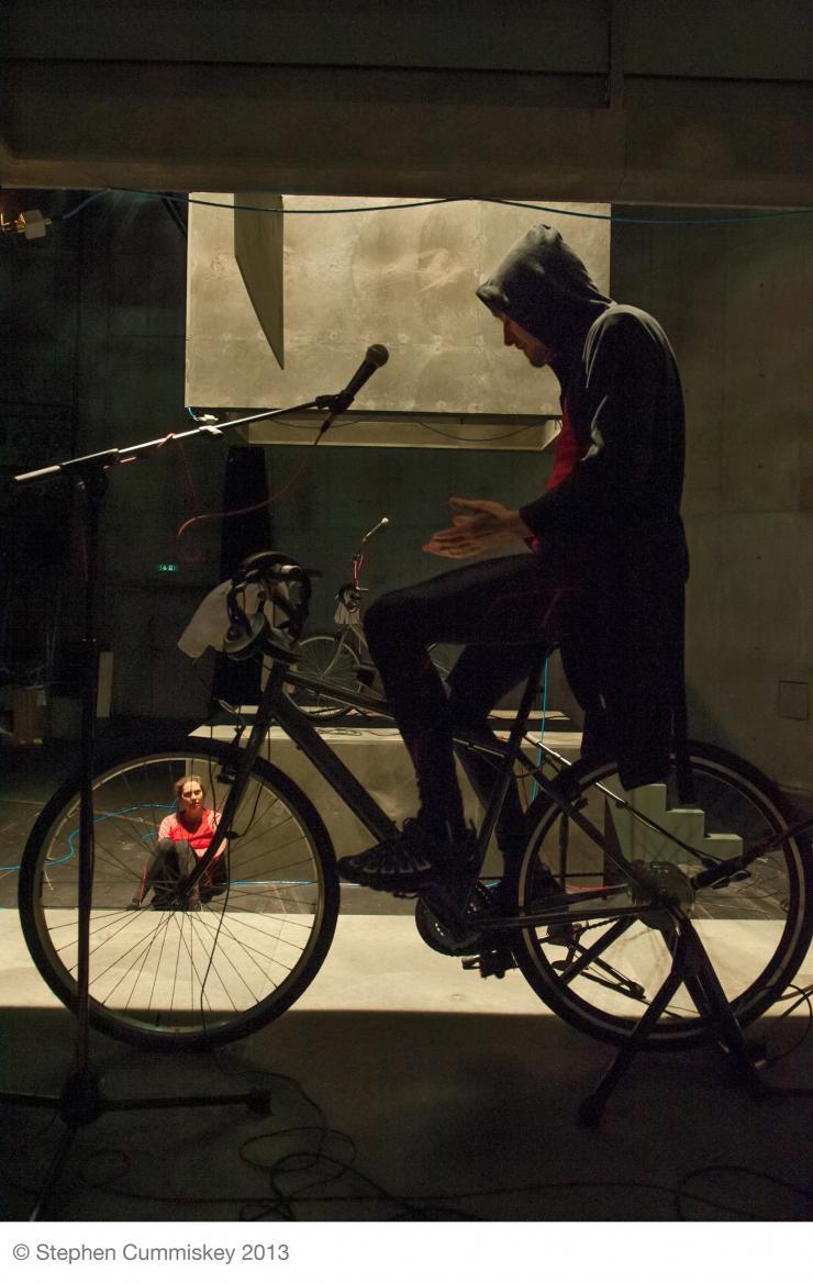 an actor on a bike