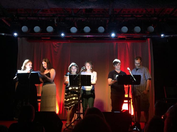 six actors perform in a staged reading