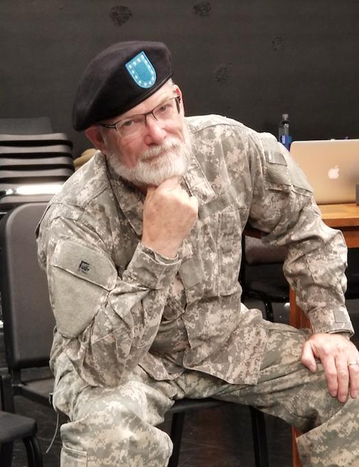 Tim Schleis sitting in uniform
