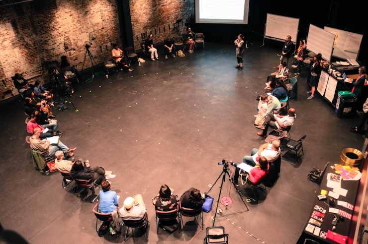 a circle of people sitting at a convening