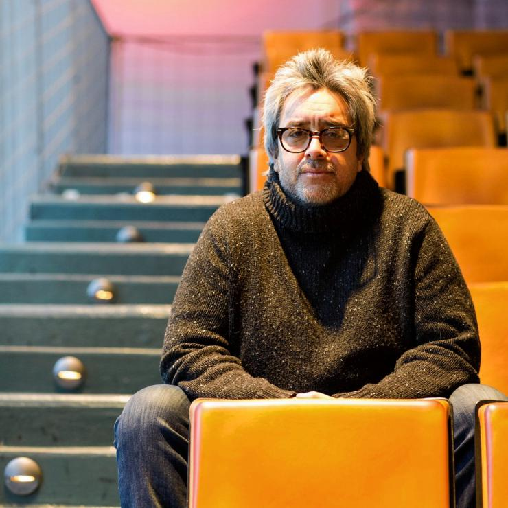 a man sitting in a theater