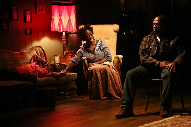 Three actors in a living room set