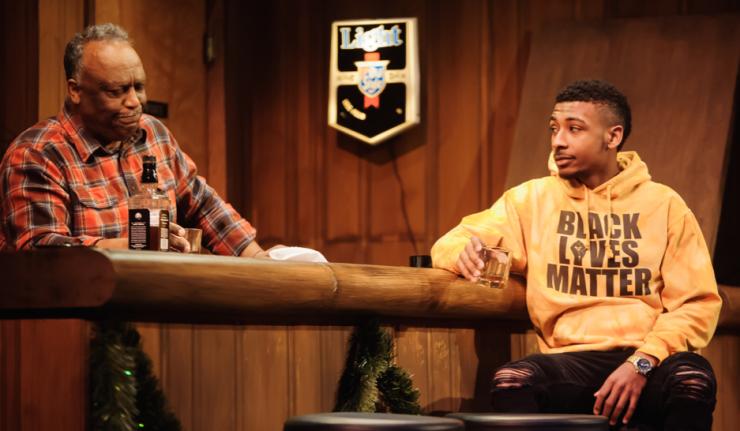 two actors sit at a bar