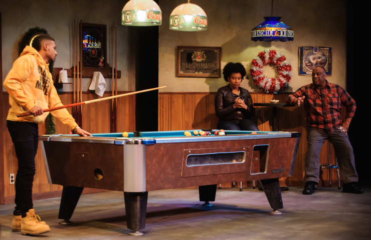 three actors playing pool