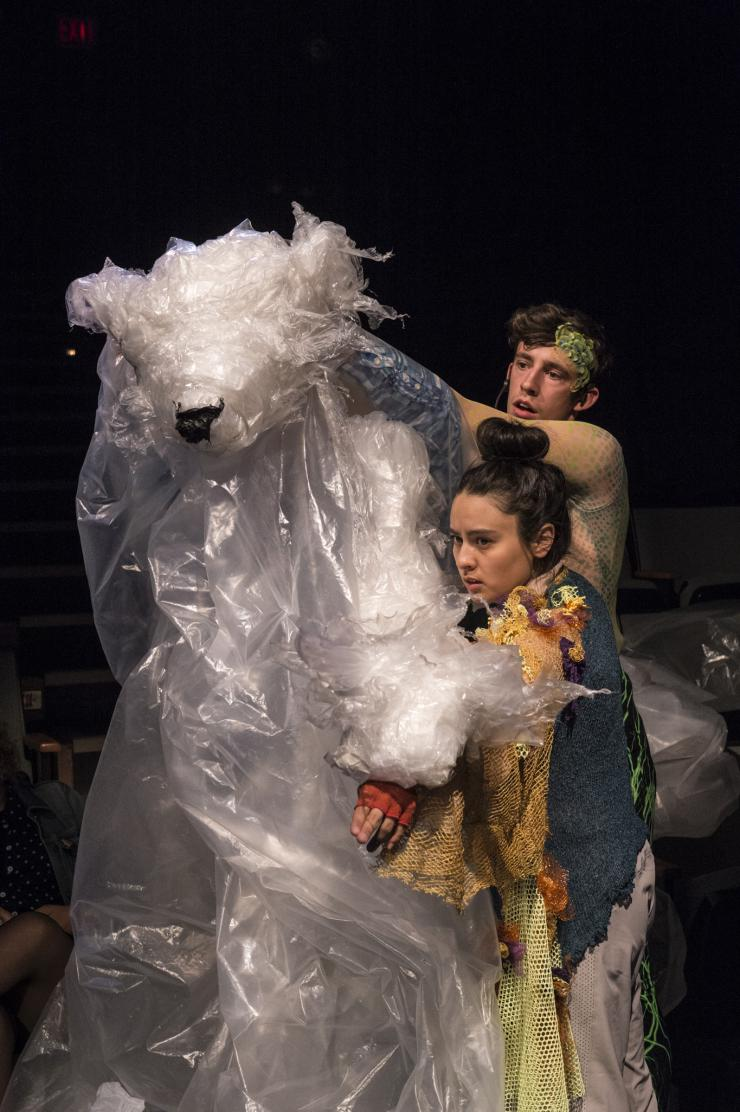 two performers maneuvering a puppet