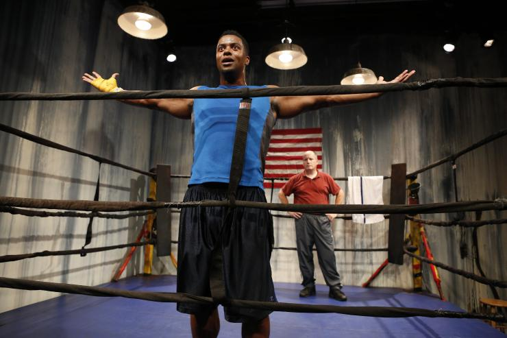 Two actors in a boxing ring