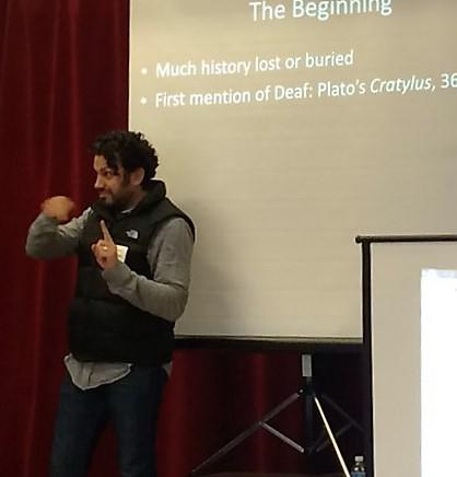 man giving a speech using sign language