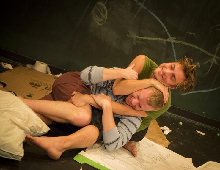 Two actors wrestling