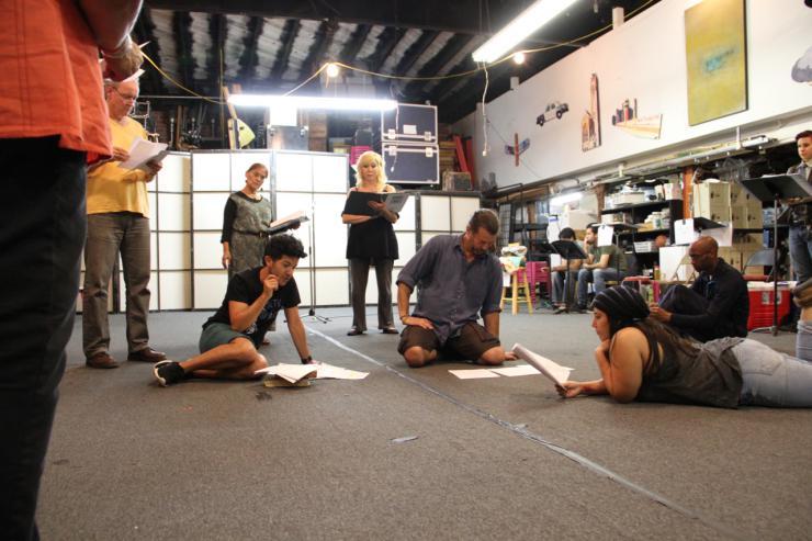 Actors around a circle in a studio