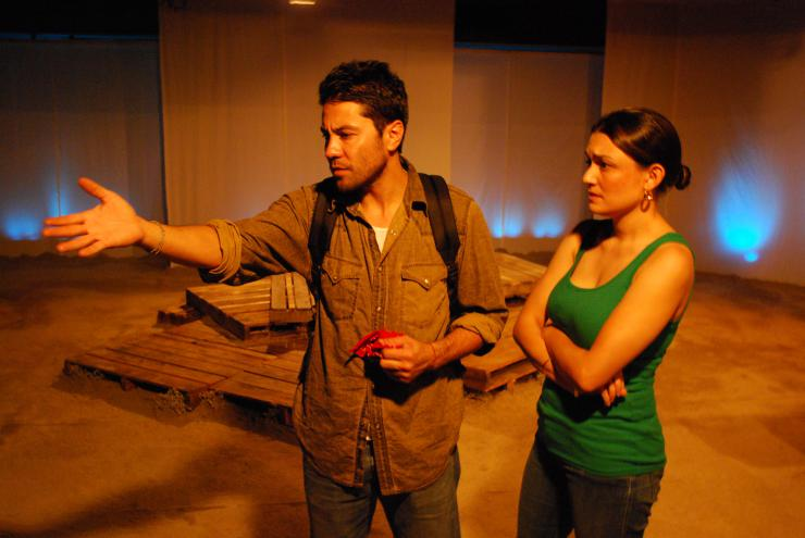 an actor and an actress performing a scene