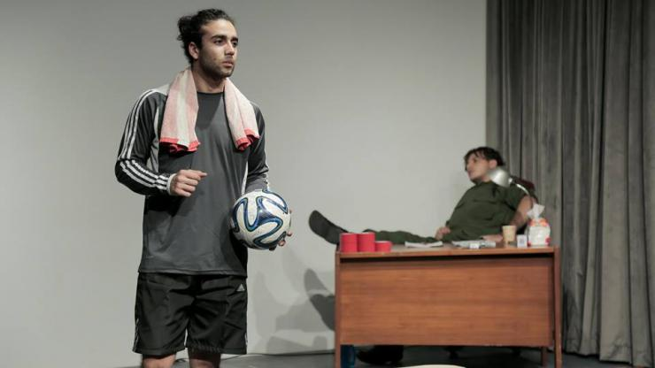an actor holding a soccer ball