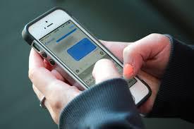 A iPhone sending a text.