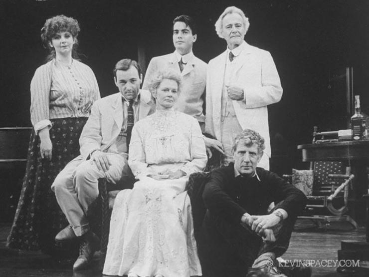Five actors and the director sitting on stage.