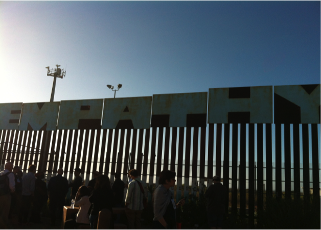 "Sign above the US-Mexico border reading ""empathy"""