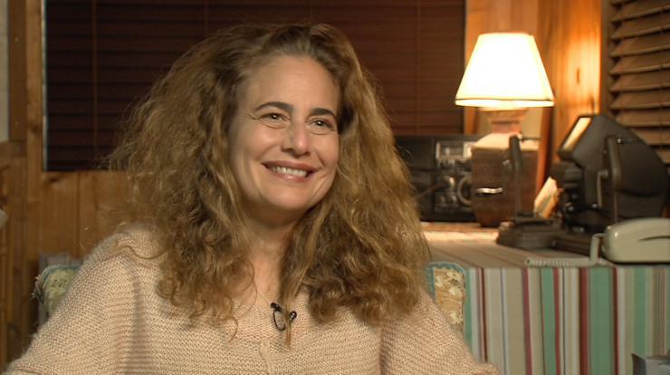 A woman smiling at a camera