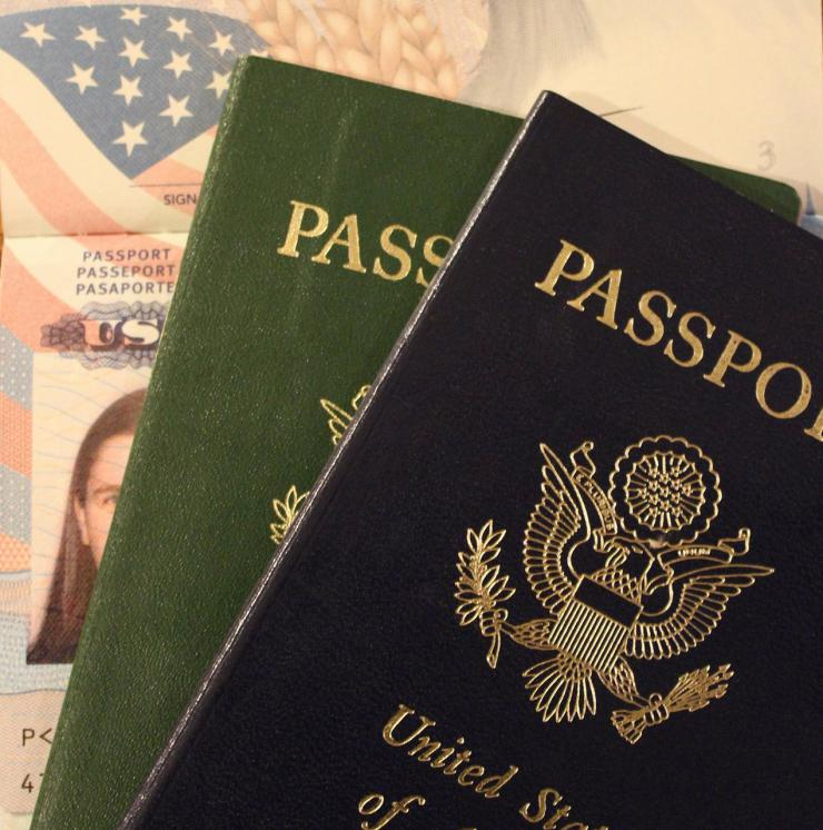 close up image of three passports