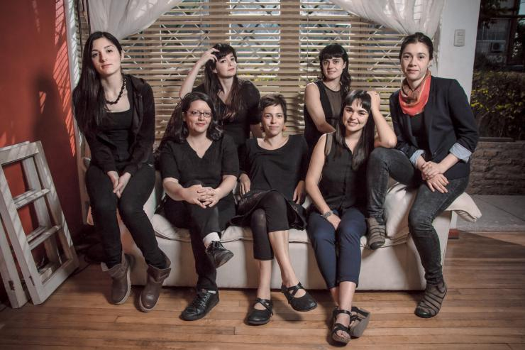 Chilean Theatremakers sitting together on a couch