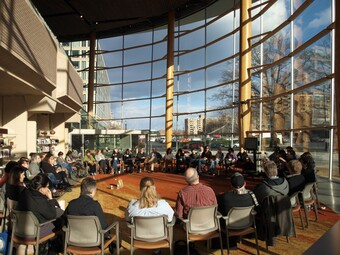 Convening attendees sit in a circle