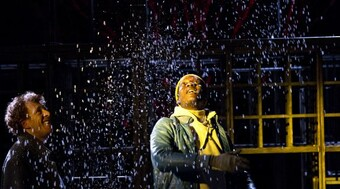 Performer looking a snow falling on stage