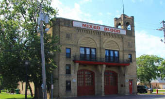 "A brick building with a sign that reads ""mixed blood."""